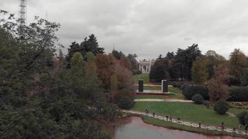 Drone passing trees in Sempione Park, Parco Sempione, Milan video