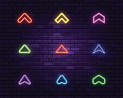Neon arrow heads collection on dark background vector