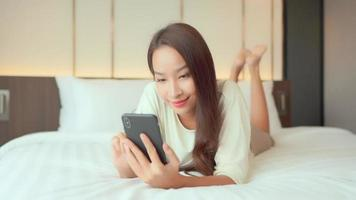 Woman use smart mobile phone on bed video
