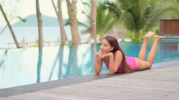 Young asian woman on vacation relax with swimming pool video