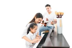 Family playing music on a white background photo