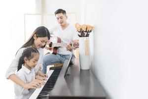 Family playing music together photo
