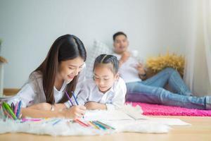 Family drawing at home photo