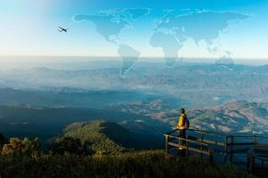Travel concept with man on mountain top photo