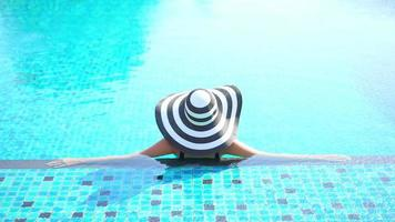 Asian Woman Wear Straw Hat Relax in Pool video