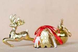 Miniature workers teaming up to paint a Christmas decoration, Christmas and Happy New Year concept photo