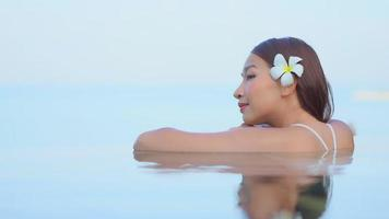 Woman Relaxes in Infinity Outdoor Swimming Pool video