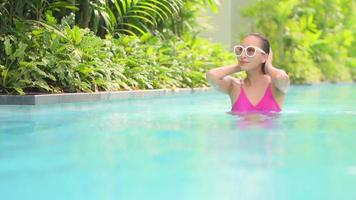 Asian Woman Around Swimming Pool in Resort video