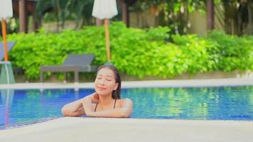 Young asian woman leisure around outdoor swimming pool video