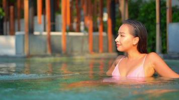 Woman Enjoy Around Pool in Resort Hotel