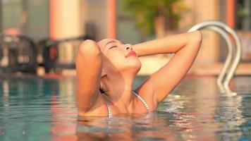 Woman Relaxes Around Pool in Hotel Resort video