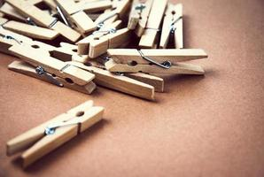 Clothespins on a brown background photo