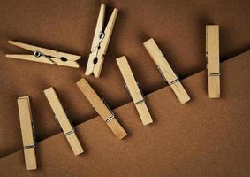 Clothespins on brown paper photo