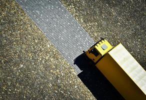 Yellow truck on stone pavement