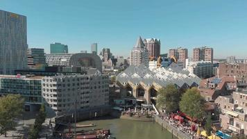 Aerial footage flying from a harbor into a tourist district of the city of Rotterdam, Netherlands.