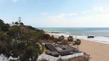 Luxury Sea View over beachside hotel and mediterranean shore in Albufeira, Algarve, Portugal - Reveal Fly-over shot video