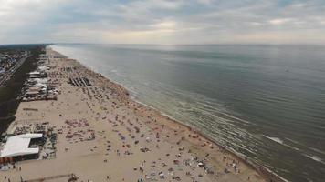 Aerial footage of a crowded beach along a North Sea resort near Zandoort, Netherlands. video