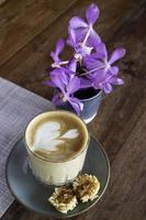 Latte and purple flower arrangement photo