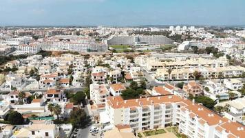 Aerial 4k drone footage panning the horizon, revealing the European popular coastal resort town of Albufeira, Portugal. video