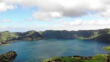 Panoramic view of Lagoa Azul, Blue Lake, in Sete cidades, Ponta Delgada, Azores - Fly forward aerial video