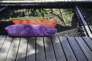 Colorful pillows on net seat photo