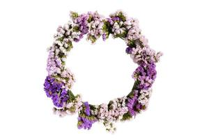 Circle pattern of beautiful flowers isolated on a white background photo