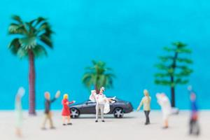 Miniature bride and groom on a beach, wedding concept photo