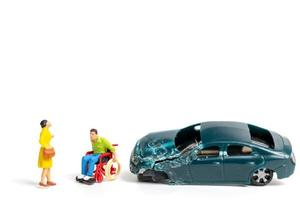 Miniature people at the scene of a car accident, car crash on a white background, drive safely concept