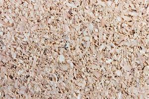 Corkboard texture background, recycled compressed wood surface