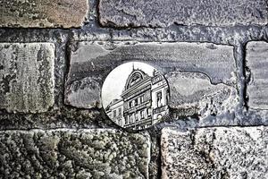 Metal plate on the floor of the city of Gent, Flanders, Belgium photo