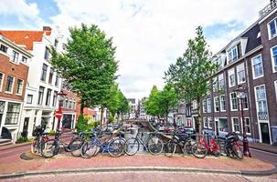 Bikes on the bridge in Amsterdam, Netherlands photo