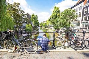 A man sitting down in one bridge of Utrecht, Netherlands photo