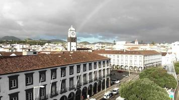 Ponta Delgada city center in an overcast day in Sao Miguel Island, Azores, Portugal - Crane up panoramic Aerial video
