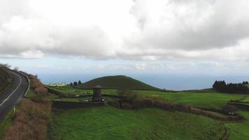 Coastal road by Atlantic Ocean . Green rural farmland. Sao Miguel Islands, Azores. video