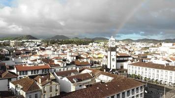 Aerial view of Ponta Delgado cityscape with rainbow , Sao Miguel Island, Azores video
