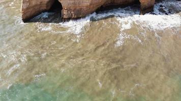 Caves in Benagil coast in Algarve, Portugal - Tilt up Reveal Aerial shot video