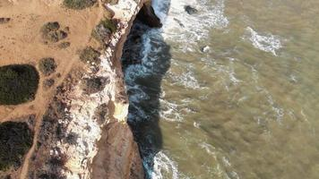 Atlantic Ocean waves on rocky coast,  Benagil Cave,  Lagoa, Algarve, Portugal video