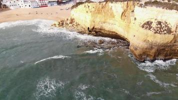 Carvoeiro Beach Resort Town in Algarve, Portugal - Tilt up Reveal Aerial shot video