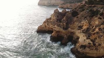 Atlantic Ocean waves washing on rock cliffs. Carvoeiro coastline , Algarve.