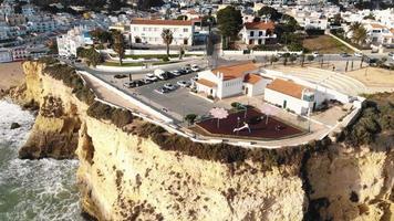 Aerial 4K drone footage revealing the coastline resort city of Carvoeiro, Portugal. video