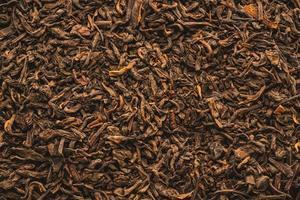 Dried black tea leaves with cinnamon photo