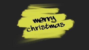 animação texto de introdução feliz natal em moda amarela e fundo de pincel video