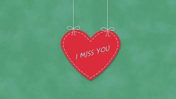 closeup animado, sinto sua falta, texto e movimento romântico grande coração vermelho no fundo do dia dos namorados video