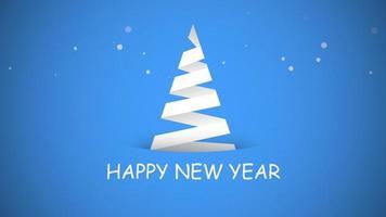 closeup animado texto de feliz ano novo, árvore de natal branco sobre fundo azul