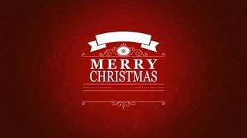 closeup animado texto de feliz natal e floco de neve em fundo vermelho de neve