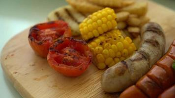 Panning Over Grilled Sausages and Mixed Vegetables