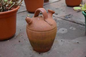 Old clay jug on the floor photo