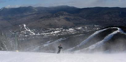 New Hampshire, USA 2017--Skier downhill at Waterville Valley Resort photo