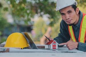 Architectural Engineer designs building construction for a house project photo
