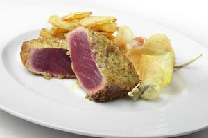 Fish dish escalope bluefin tuna breading capers and potatoes photo